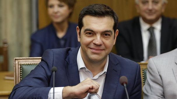 Alexis Tsipras holds the first cabinet meeting of his new government (AP)