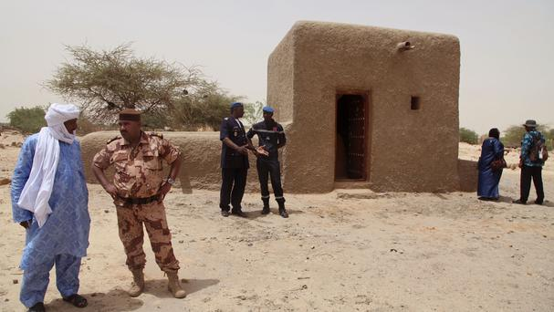 A now-restored mausoleum in Timbuktu that was hit by Islamic extremists in 2012 (AP)