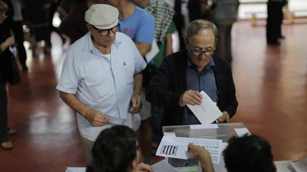 Voters go to the polls in Barcelona (AP)