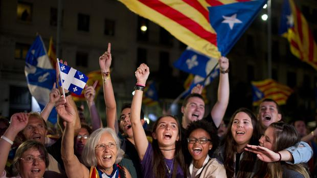 Catalonian pro-independence supporters celebrate in Barcelona (AP)