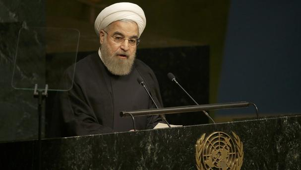 Iran's President Hasan Rouhani says his country cannot work with any government promoting regime change in Syria (AP)