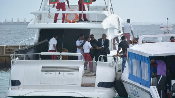 Injured people are evacuated after a blast on Maldives President Yameen Abdul Gayoom' speedboat in Male (Yoosuf Sofwan/Sun Online via AP)