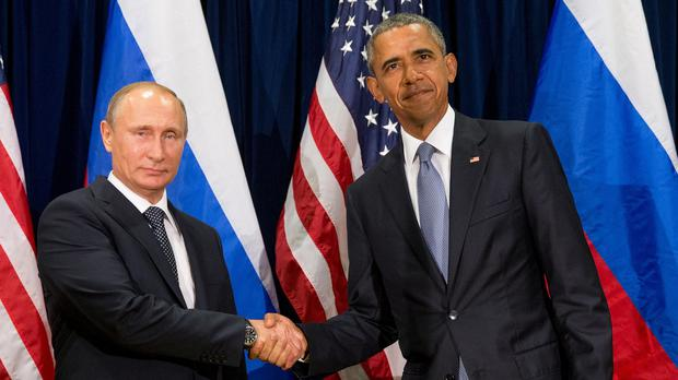 Vladimir Putin and Barack Obama before their meeting at the United Nations headquarters (AP)