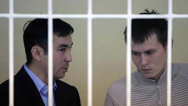 Yevgeny Yerofeyev, left, and Alexander Alexandrov during a trial hearing in Kiev, Ukraine. (AP)