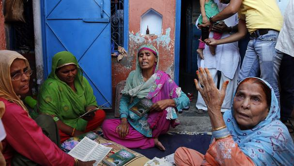 Relatives mourn the killing of 52-year-old Muslim farmer Mohammad Akhlaq at his home in Bisara. (AP)