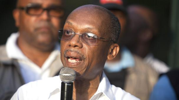 Haiti's former president Jean Bertrand Aristide during a an election campaign meeting in Port-au-Prince (AP)