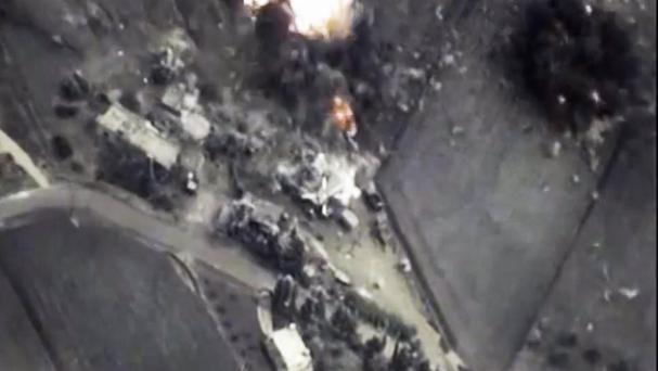 Footage from the Russian defence ministry official web site shows a bomb explosion in Syria (Russian defence ministry/AP)