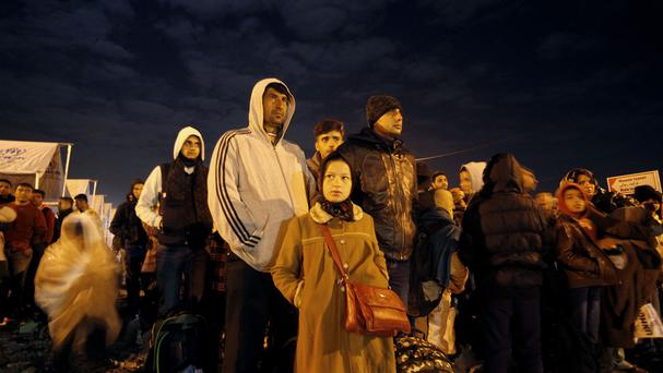 Migrants and refugees wait for a train towards Serbia. (AP)