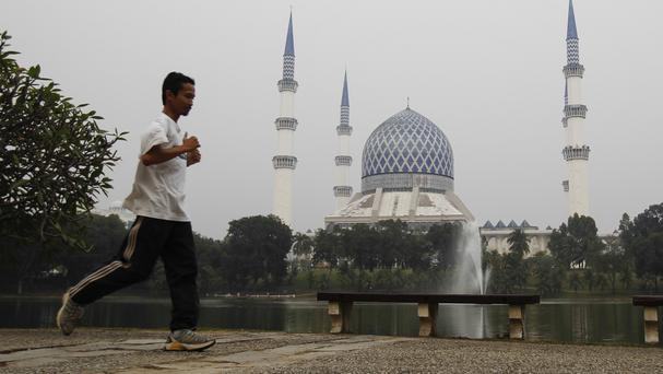 The Blue Mosque slightly obscured by haze caused by the burning of forests in Indonesia's Sumatra and Borneo islands (AP)