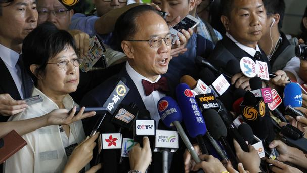 Donald Tsang, former leader of Hong Kong, talks to reporters outside court in Hong Kong (AP)