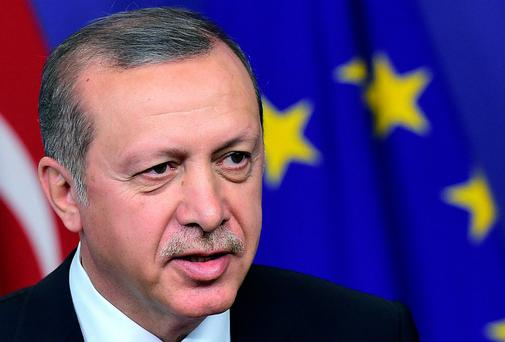 Turkey's president Recep Tayyip Erdogan arrives to meet with European Commission President Jean-Claude Juncker