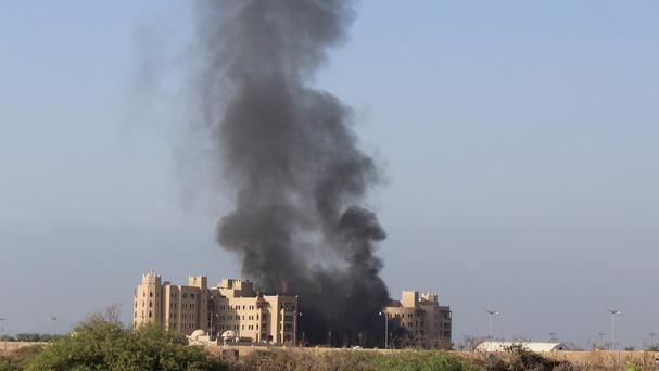 Smoke rises following an explosion that hit Hotel al-Qasr where Cabinet members and other government officials are staying, in the southern port city of Aden, Yemen (AP)