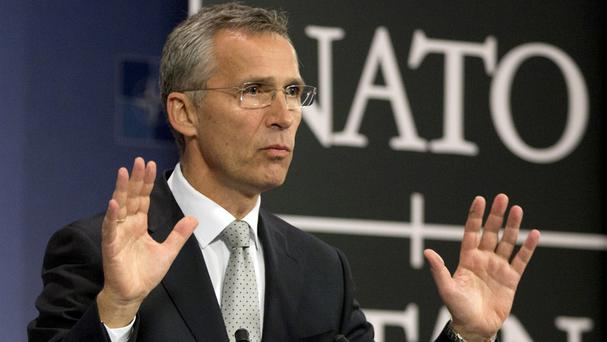 Nato secretary general Jens Stoltenberg speaks during a media conference at Nato headquarters in Brussels (AP)