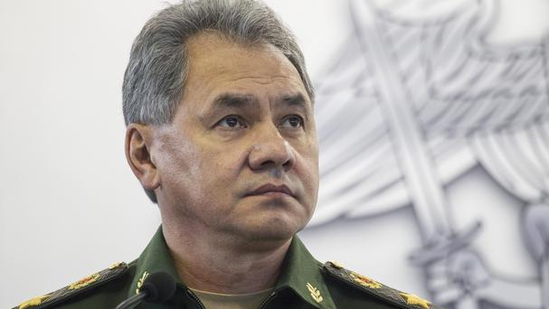 Defence minister Sergei Shoigu said Russia carried out missile strikes from four warships of its Caspian Sea flotilla (AP)
