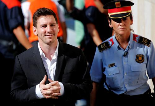 Lionel Messi, left, arrives at a previous court date to answer questions in a tax fraud case in Gava, near Barcelona, Spain. Photo: AP