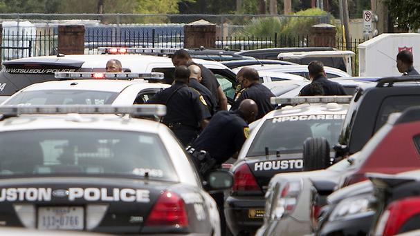 Police search the scene of the fatal shooting at Texas Southern University (Houston Chronicle/AP)