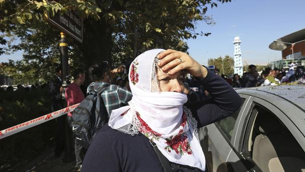 A woman at the site of the explosion in Ankara (AP)