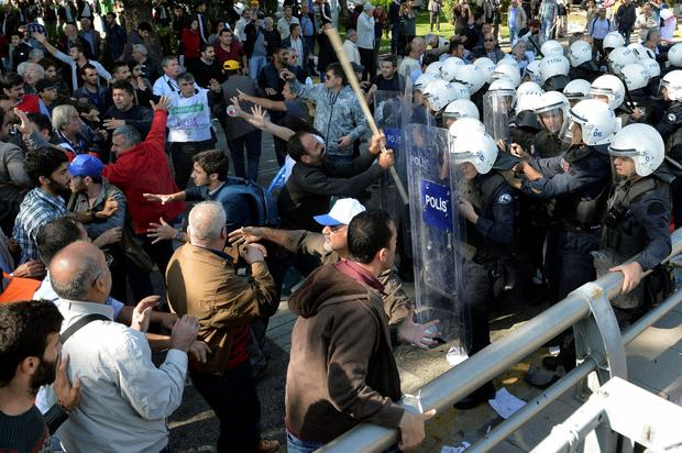 After the explosion, demonstrators attacked police