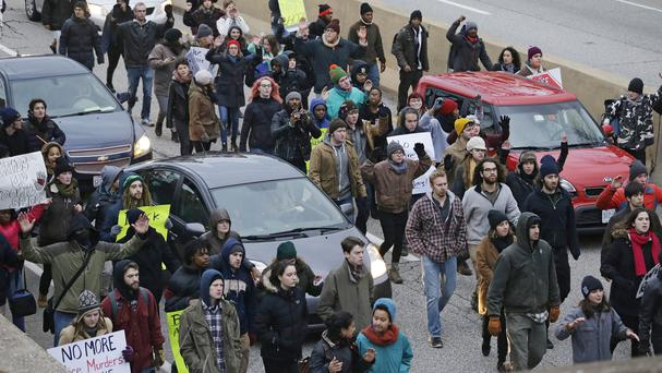 Protesters block cars during a protest last year over the police shooting of Tamir Rice in Cleveland (AP)