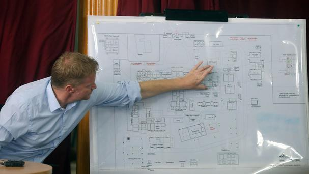 Doctors Without Borders general director Christopher Stokes shows a map of the organisation's building in Kunduz (AP)