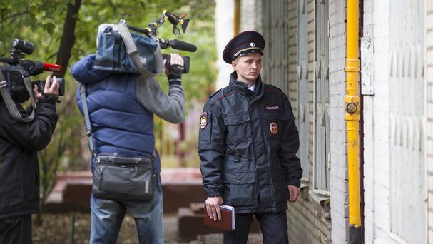 A Russian policeman stands at an entrance of the building where homemade explosives were found in Moscow (AP)