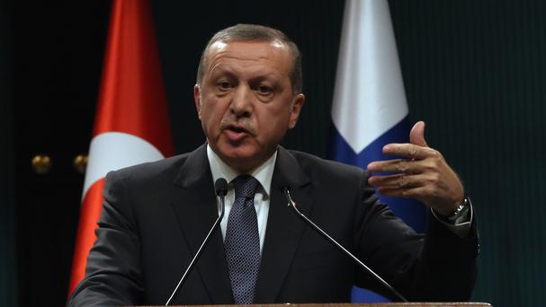 Turkish president Recep Tayyip Erdogan speaks to the media during a joint news conference with his Finnish counterpart Sauli Niinisto in Ankara (AP)