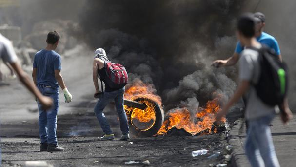 Palestinians during clashes with Israeli troops near Ramallah, West Bank. (AP)