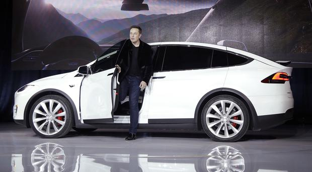 Elon Musk with the Model X car at the Tesla headquarters in Fremont, California. (AP)