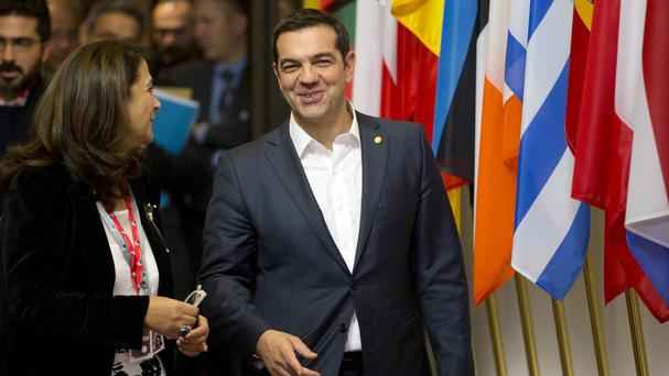 Greek prime minister Alexis Tsipras leaves after an EU summit in Brussels ahead of a vote by his country on his latest cost-cutting measures (AP)
