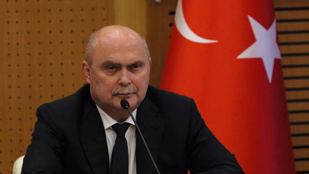 Turkish foreign minister Feridun Sinirlioglu said the drone crashed about two miles inside Turkish territory (AP)