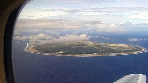 Refugees who attempt to reach Australia are transferred to immigration detention camps on the island nations of Nauru, pictured, and Papua New Guinea