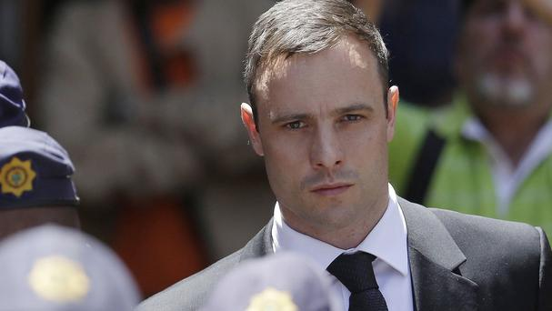 Oscar Pistorius has been released from prison and placed under house arrest (AP)