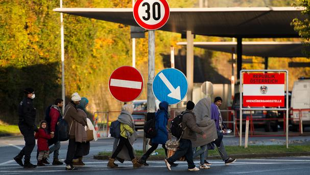 Migrants guided by police crossing the Austrian - Slovenian border into Austria, in Sentilj, Slovenia (AP)