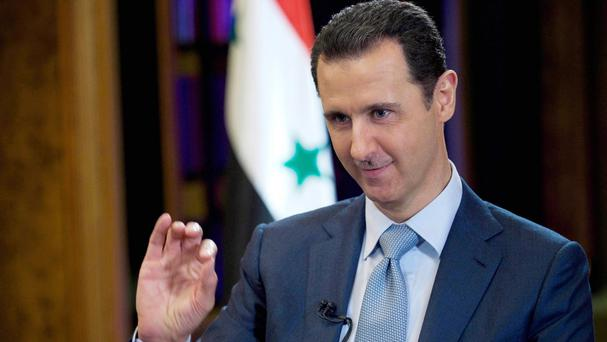 Syrian state media says Bashar Assad has met his Russian counterpart, Vladimir Putin, in Moscow (SANA via AP)
