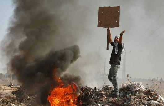 Hatred: A Palestinian protester during clashes with Israeli troops near the border with Israel.