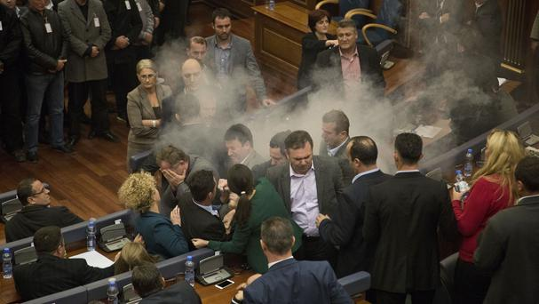 Tear gas smoke rises as scuffles break out between lawmakers in Kosovo's parliament (AP)