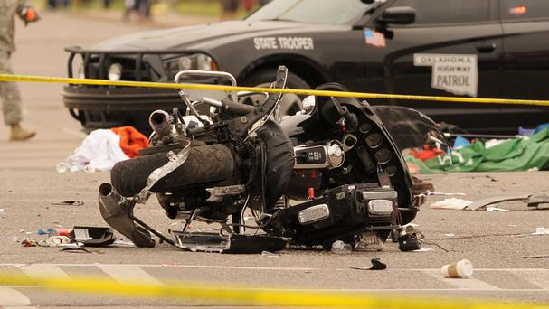 A damaged police motorcycle after a vehicle crashed into a crowd of spectators during the Oklahoma State University homecoming parade (AP)
