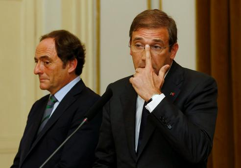 Crisis: Portuguese Prime Minister Pedro Passos Coelho (right) and deputy minister Paulo Portas hold a press meeting after talks with Socialist Party leader Antonio Costa in Lisbon