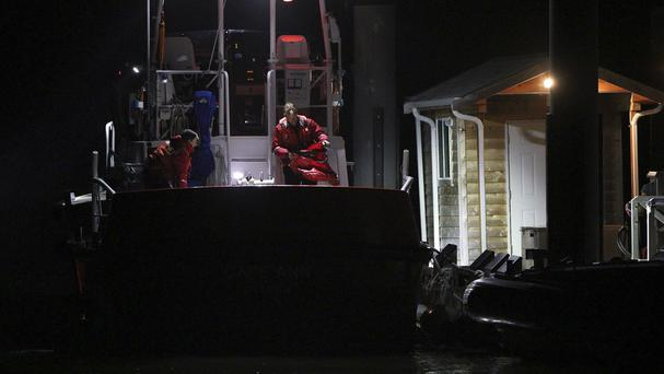 Coast Guard crew arrive at a dock in Tofino, Canada, following a search and rescue operation (Chad Hipolit/The Canadian Press via AP)