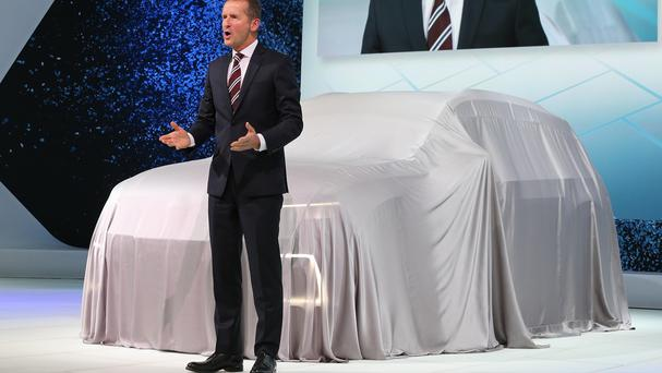 Herbert Diess apologises at the beginning of Volkswagen's press conference at the Tokyo motor show (AP)