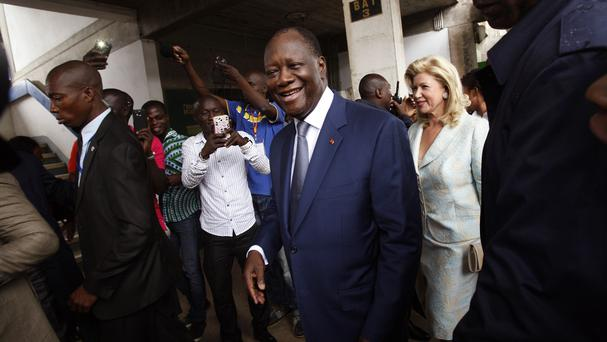Alassane Ouattara after he voted in the election in Abidjan (AP)