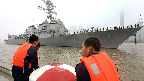 China says authorities warned the destroyer USS Lassen as it entered what the country claims as a 12-mile territorial limit around Subi Reef (AP)