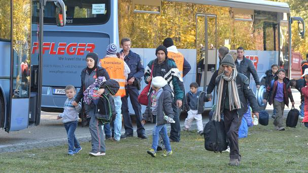 Migrants arrive by bus at the border between Austria and Germany near Kollerschlag, Austria (AP)