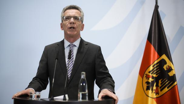 German interior minister Thomas de Maiziere briefs the media during a news conference at the Interior Ministry in Berlin (AP)