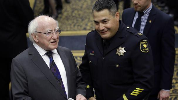 Michael D Higgins meets police officers in Berkeley to thank them for their response to the balcony collapse (AP)