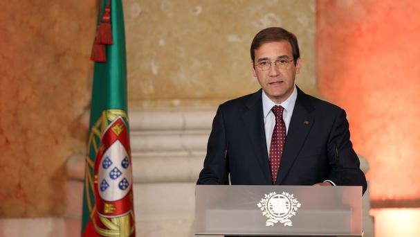 Portuguese prime minister Pedro Passos Coelho delivers his speech during the swearing in of the new government. (AP)