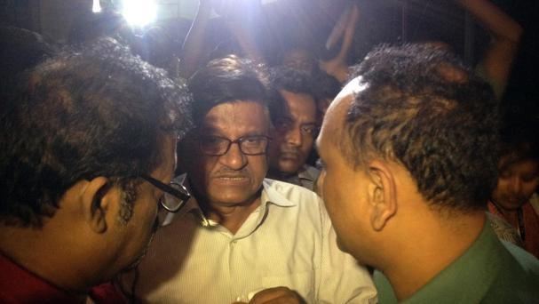 Abul Kashem Fazlul Haque, the father of Faisal Arefin Deepan, is surrounded by the media in Dhaka, Bangladesh. (AP)