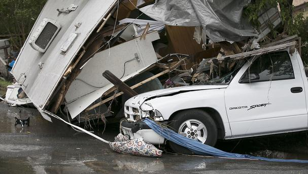 The aftermath of flooding in the Thoroughbred Farms subdivision near Elroy, Texas (AP)