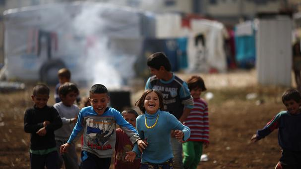 Syrian boys play at a refugee camp in the town of Hosh Hareem, in Lebanon (AP)