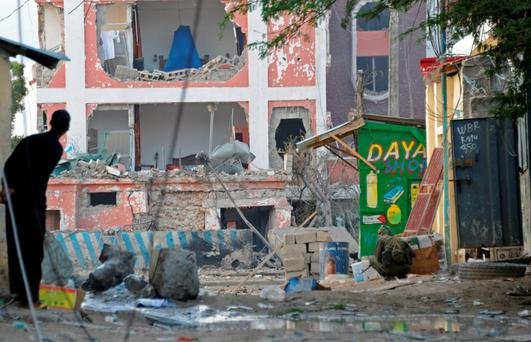 A man looks on at the hotel where at least nine were killed in the terror attack in Mogadish